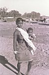 Tribal Woman Walking with her Child
