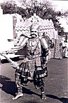 Folk artist dressed as the ten headed king Rawana