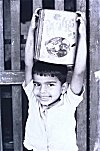 Boy Carrying Candy