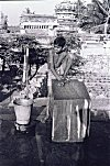 Handicapped Boy Washing Clothes With His Feet