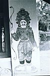 A Painted Doorman outside a Temple