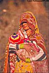 Rajasthani Woman in Veil  Carrying Child