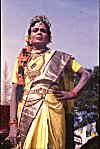 A Male Folk Artist Dressed as a Queen