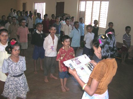 News being Read to Kids at an Orphanage